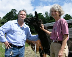 "Ric Orlando, chef/owner of New World Home Cooking, and winner of the TV show, ""Chopped,"" gets kissed by Gead, the llama, on a visit to Heather Ridge. Photo by Joy Moore"
